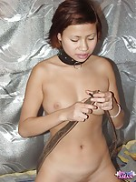 Asian putting a huge dildo in her tight pussy
