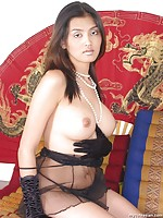 Busty Thai plugs a dildo in her asian pussy